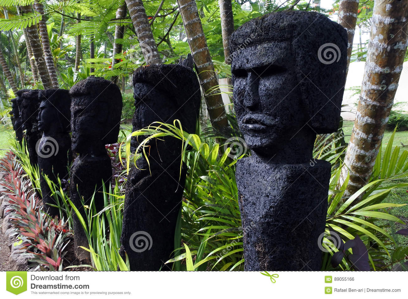 Row Of Outdoor Polynesian Human Figures Sculptures In A Garden In Fiji  Islands.