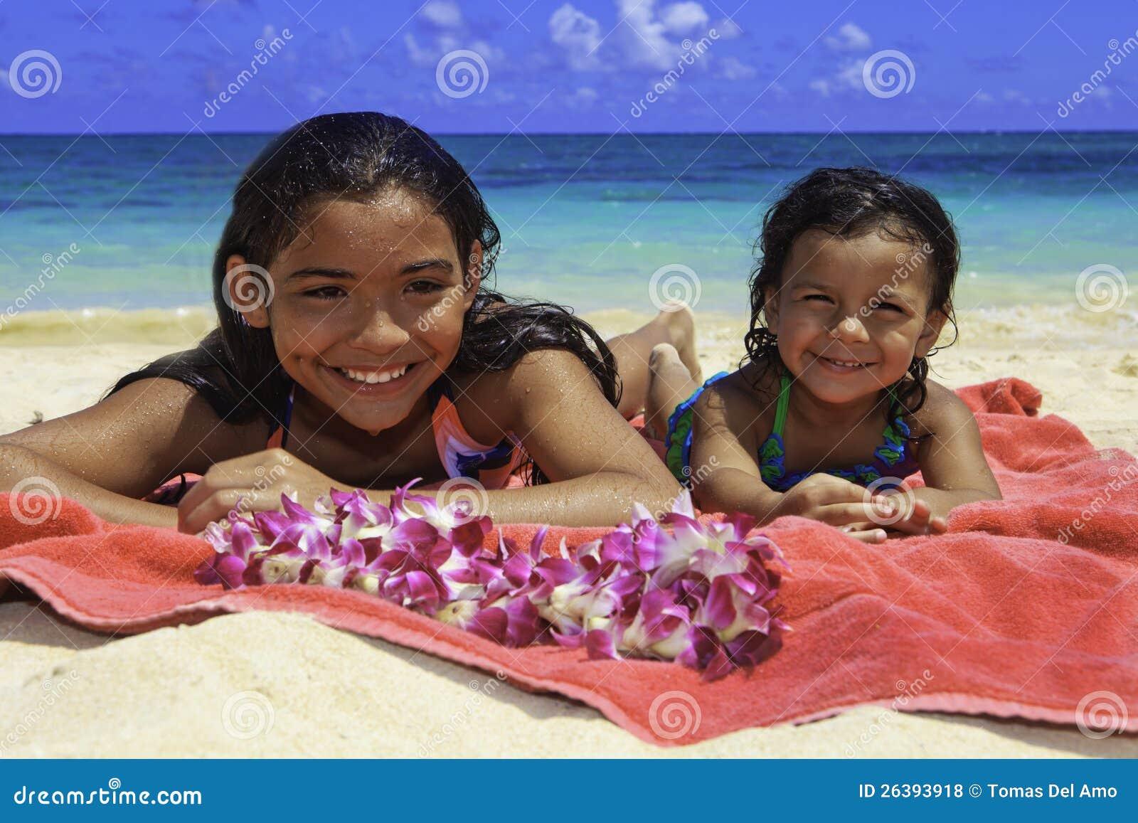Polynesian sisters at the beach