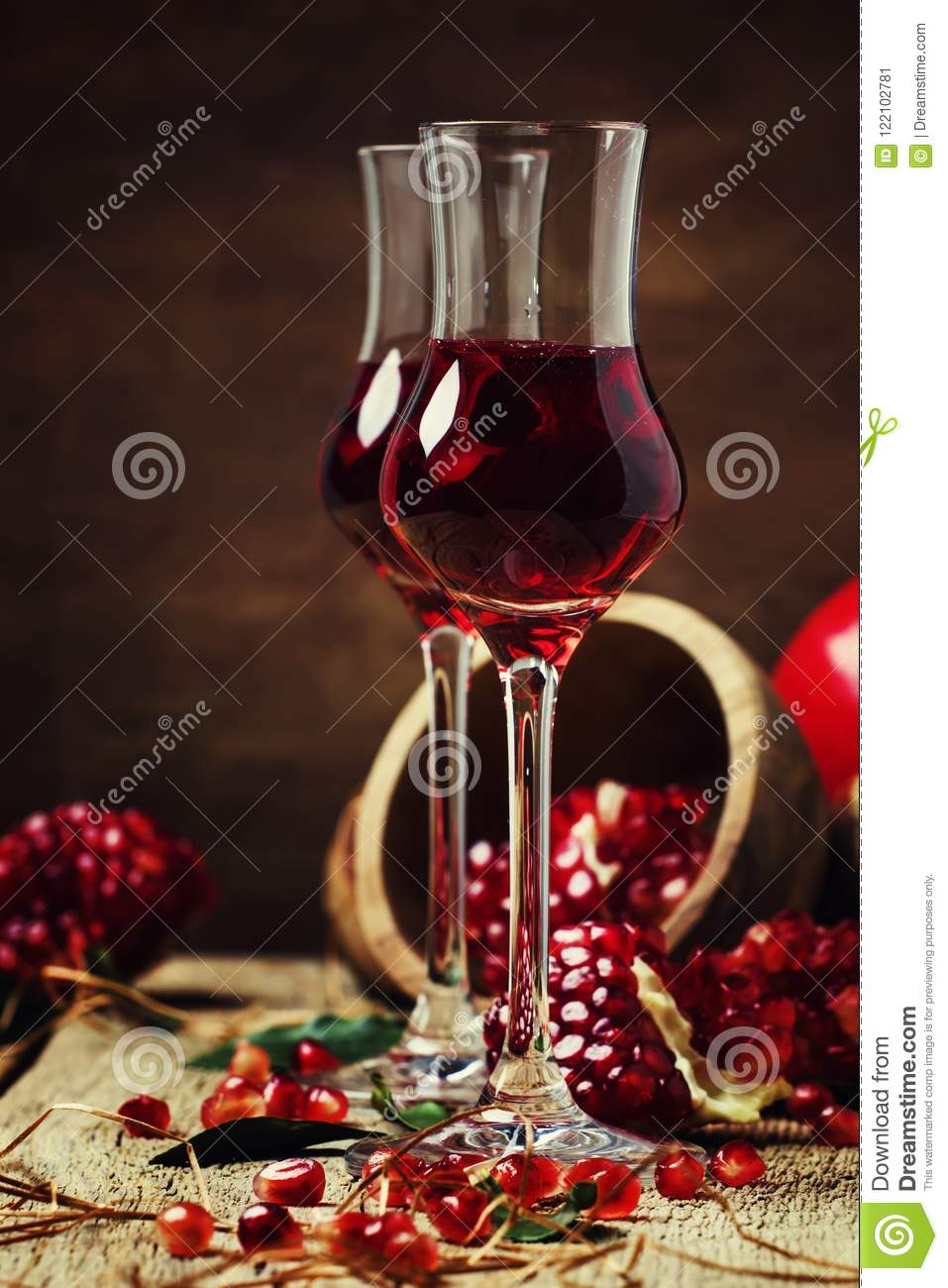 Pomegranate liqueur, still life in rustic style, vintage wooden
