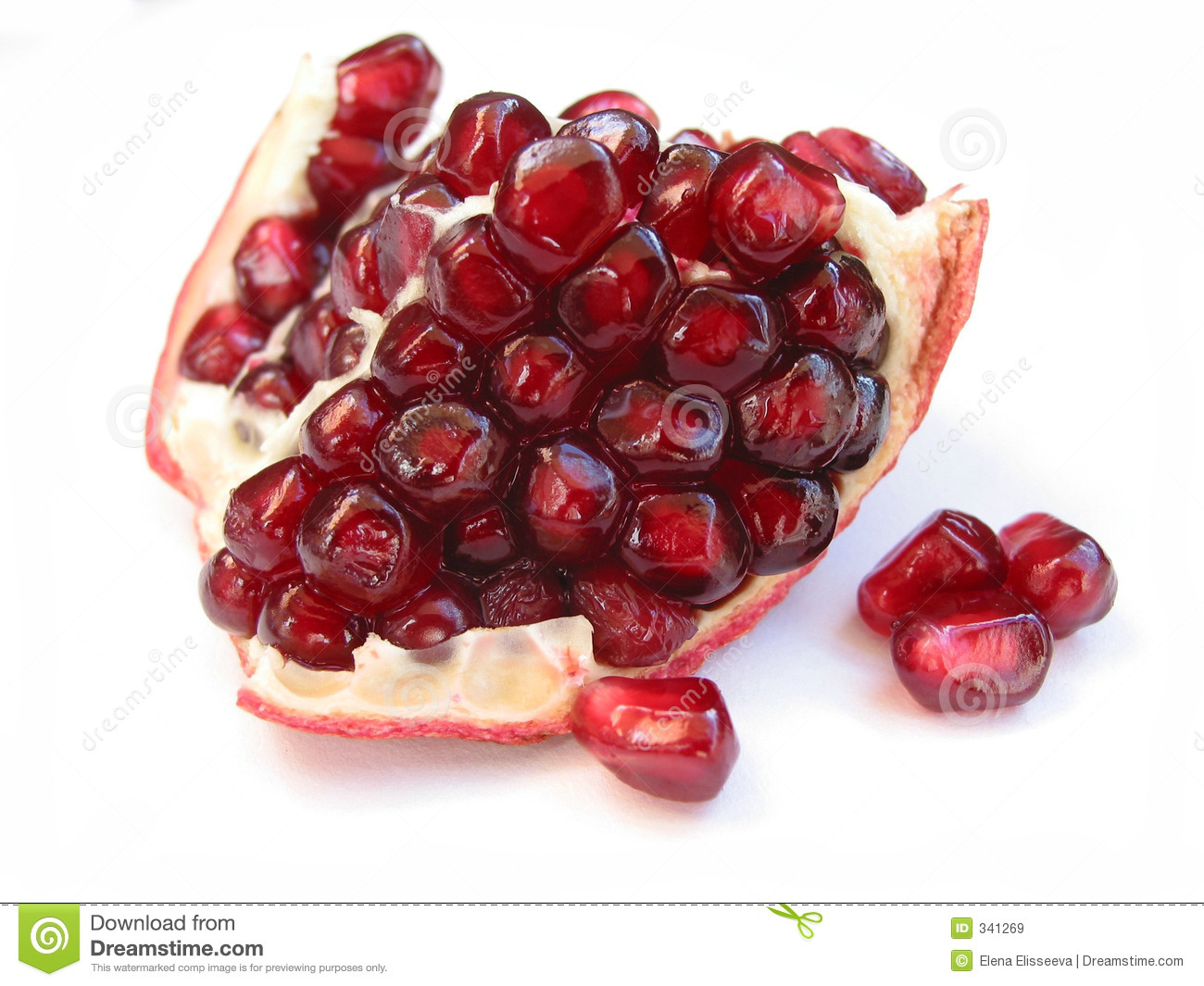 Pomegranate seeds on white