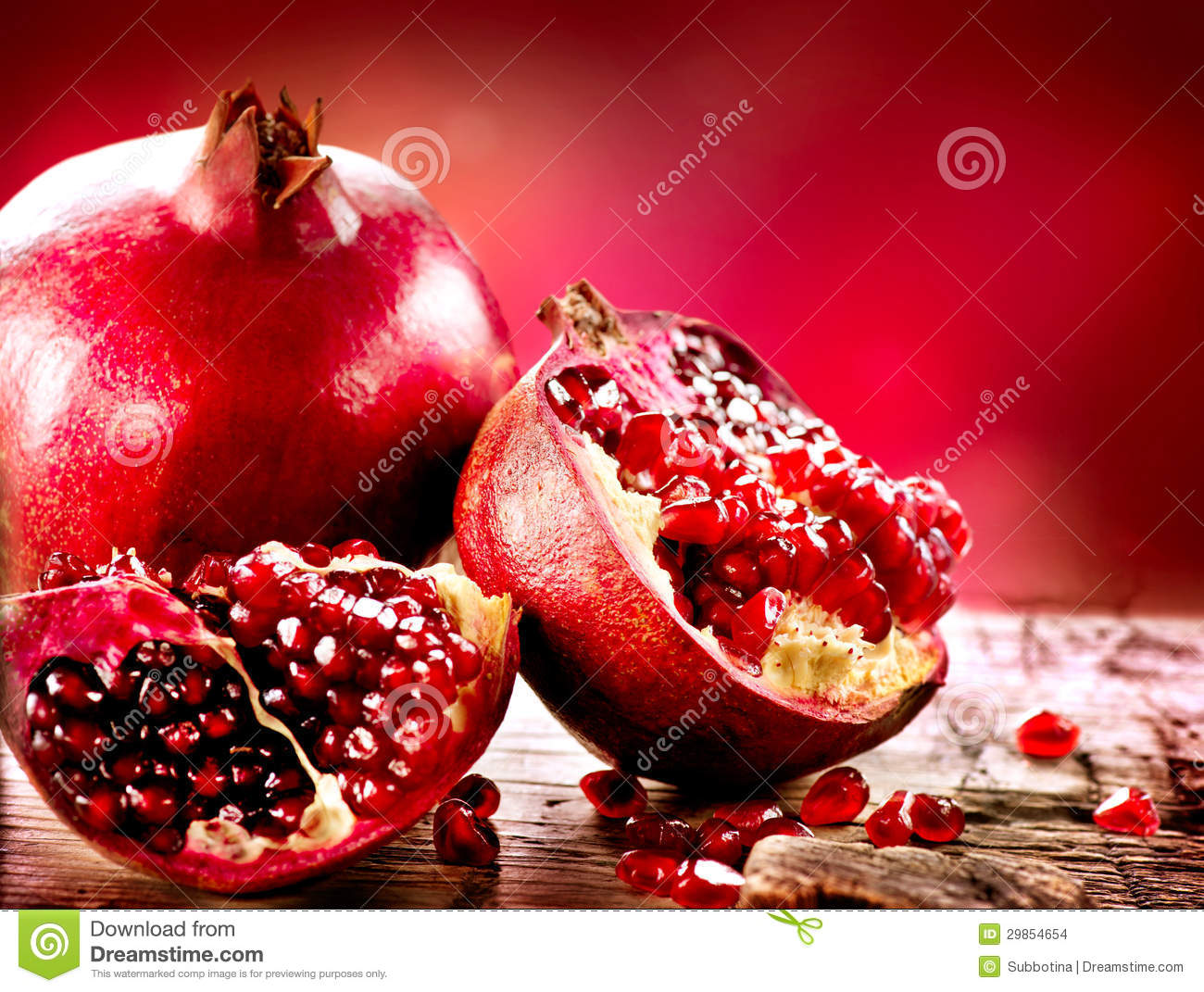 Pomegranates over Red Background