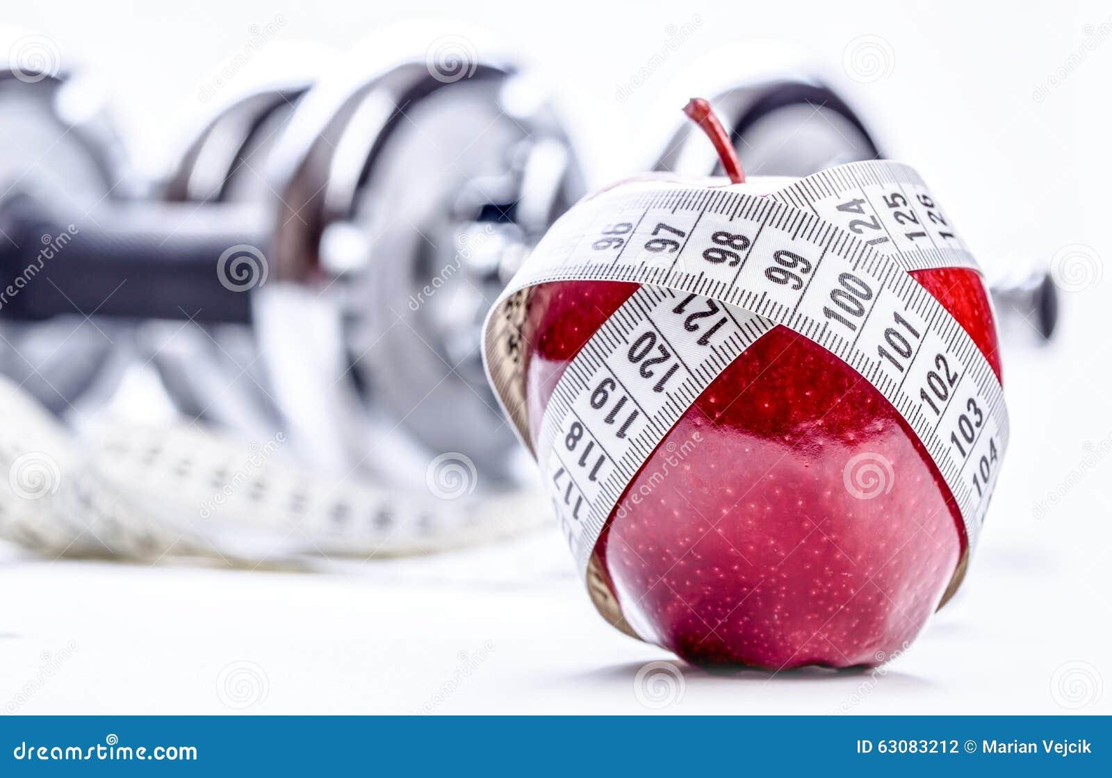 Download Pomme Rouge Fraîche, Ruban Métrique, Et Dans Les Haltères De Forme Physique De Fond Photo stock - Image du activité, fitness: 63083212