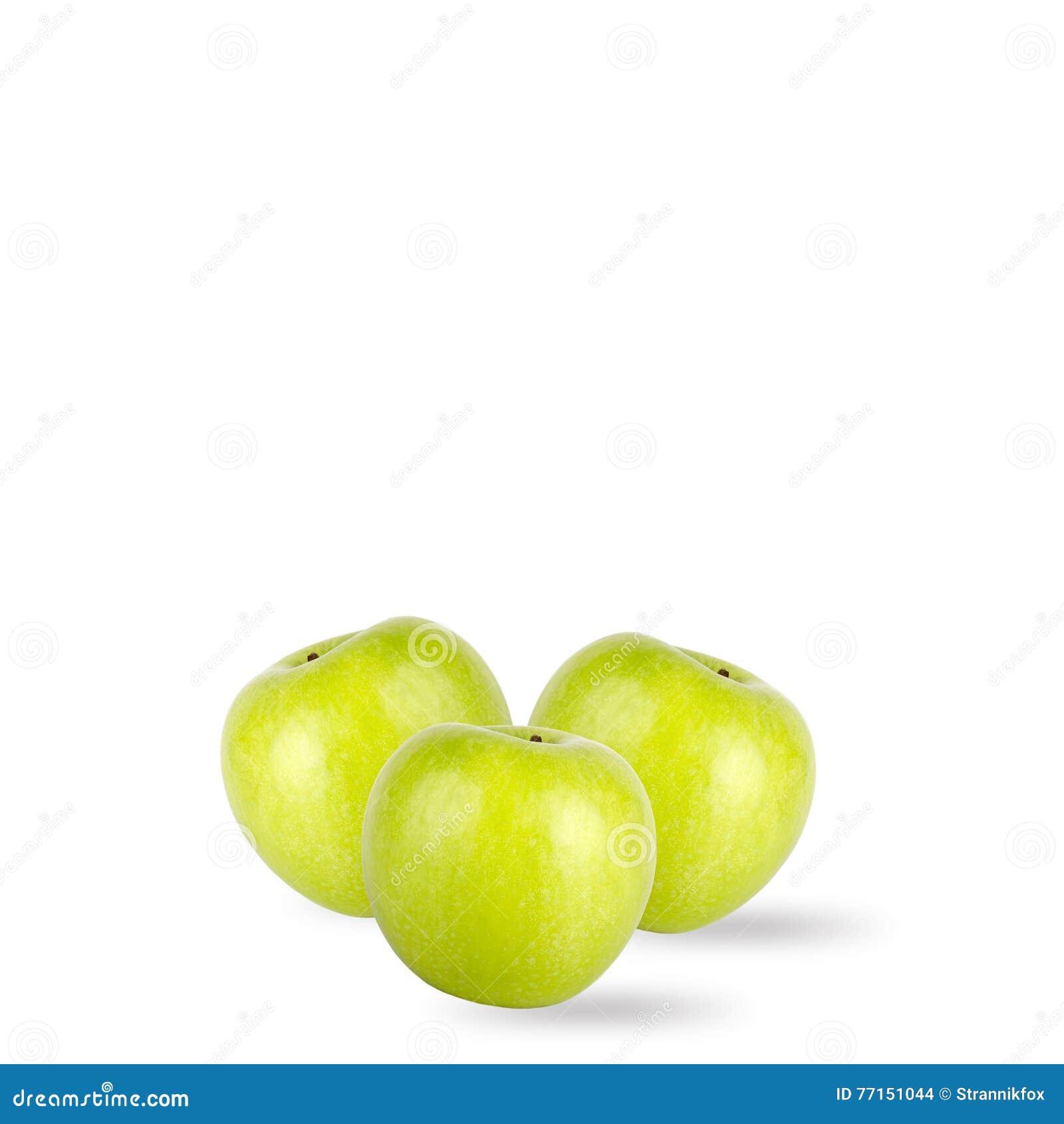 Pommes vertes d isolement sur le fond blanc