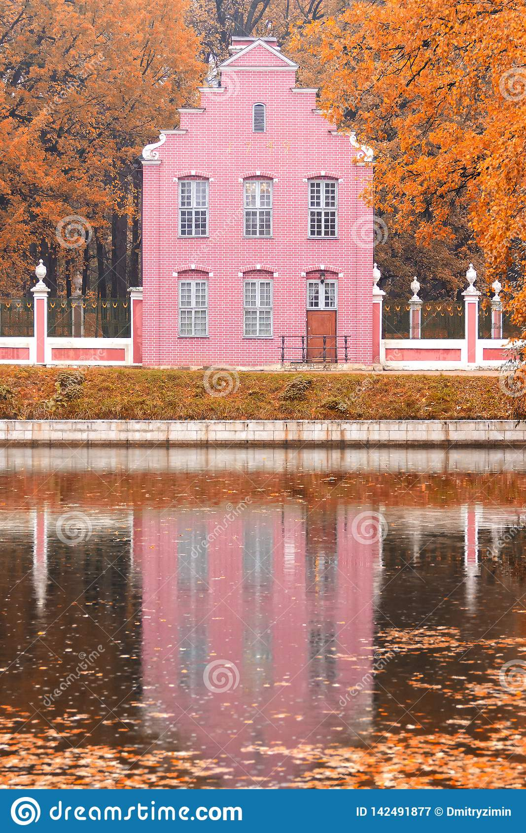 Pond and an old Dutch house in the autumn landscape in Moscow, Kuskovo, Russian Federation