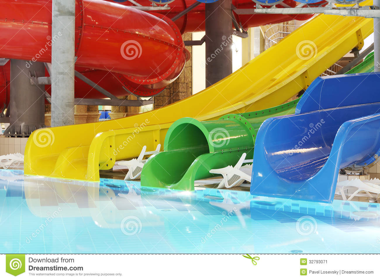 Pool with clear water and multi-colored water slides