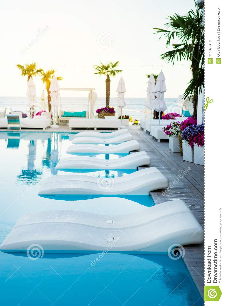Pool With Palm Tree White Umbrella And Chaise Longue Stock Image