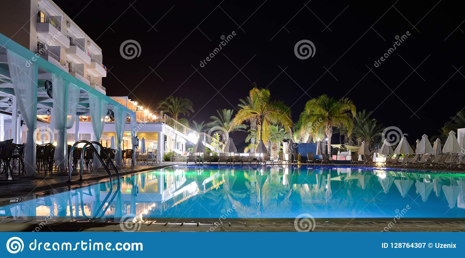 Pool in the resort at hotel in night-time with illumination