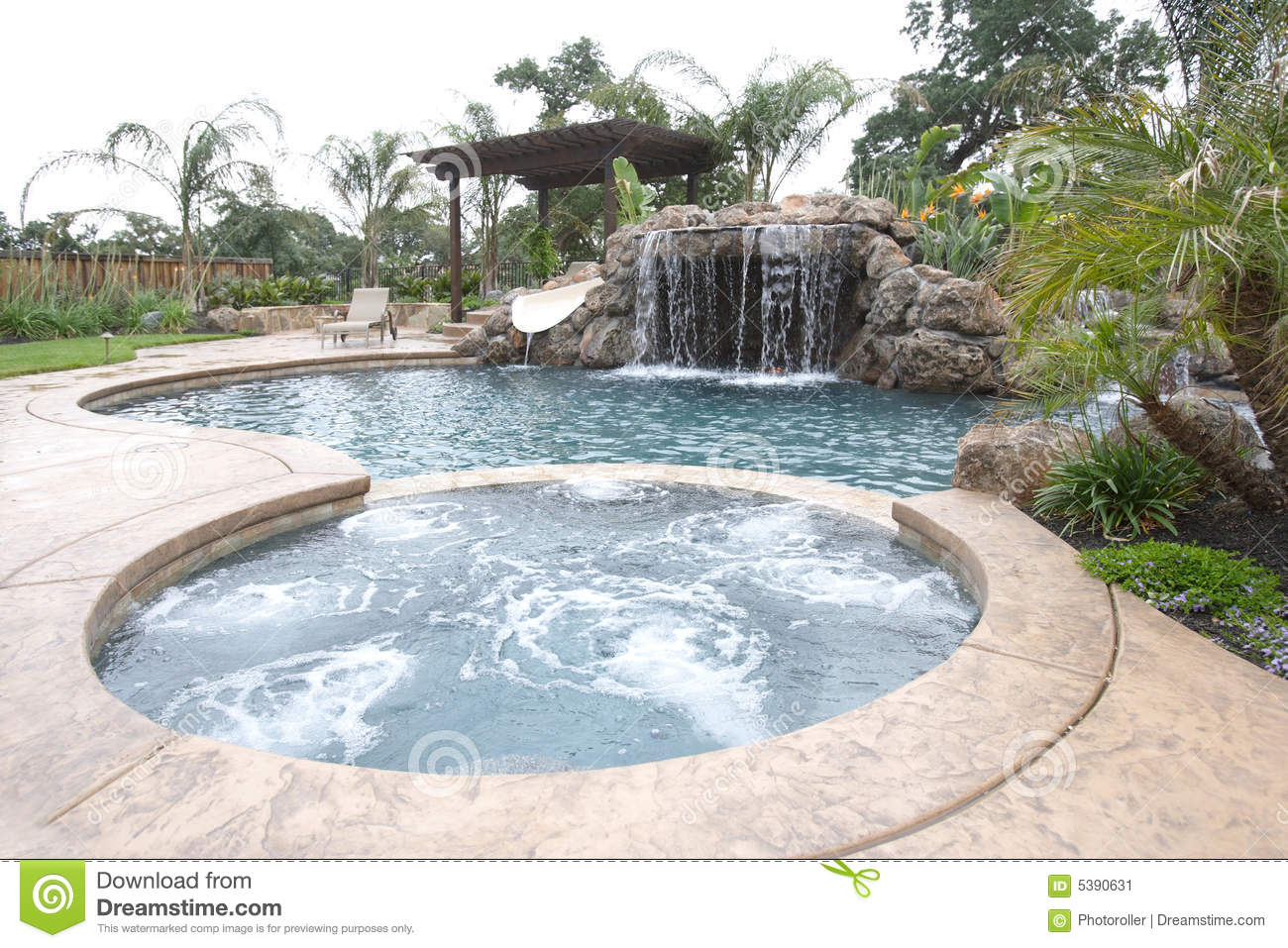 a pool with a waterfall in a luxury backyard stock image image