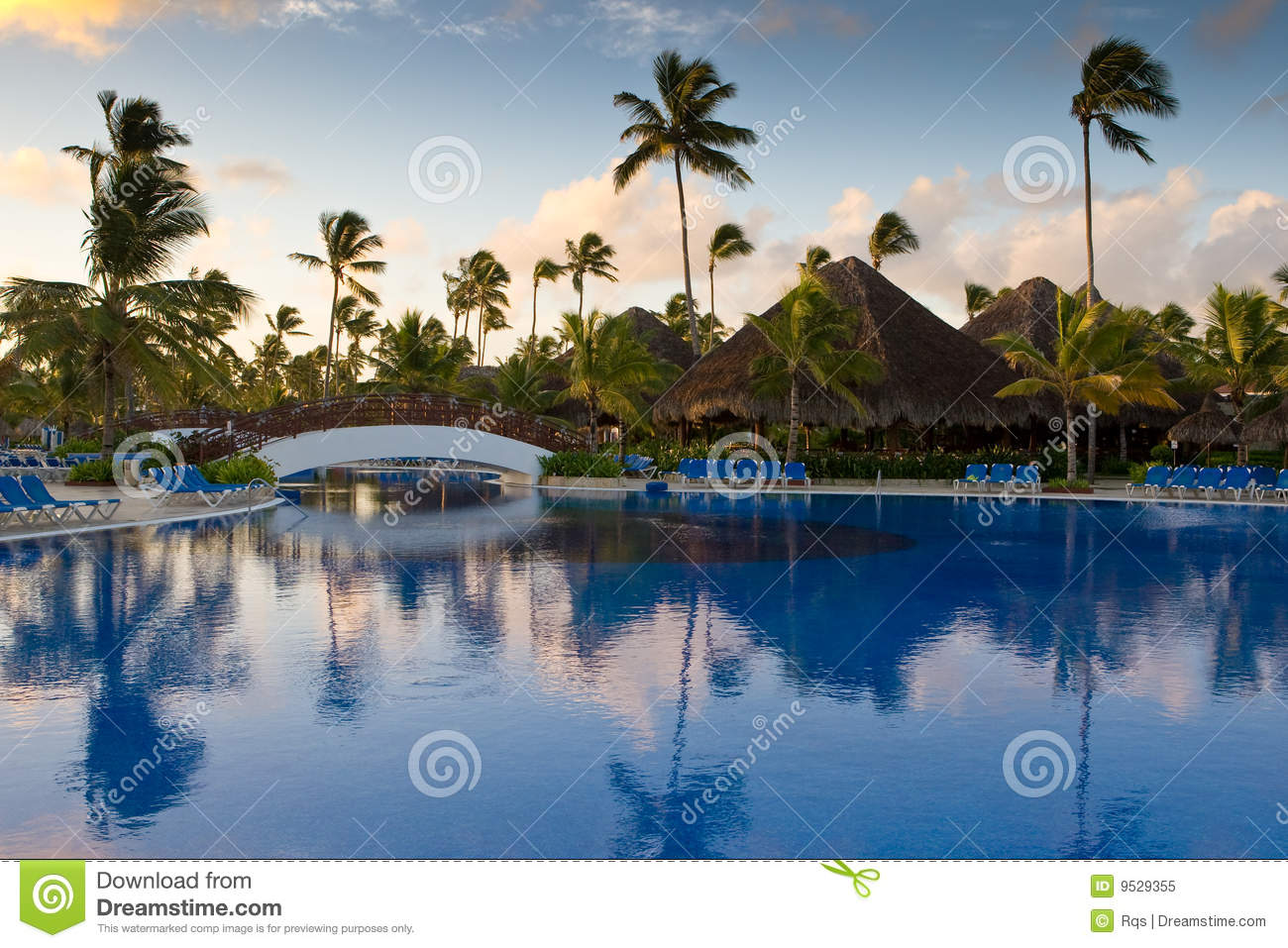 Pool with white bridge and palms