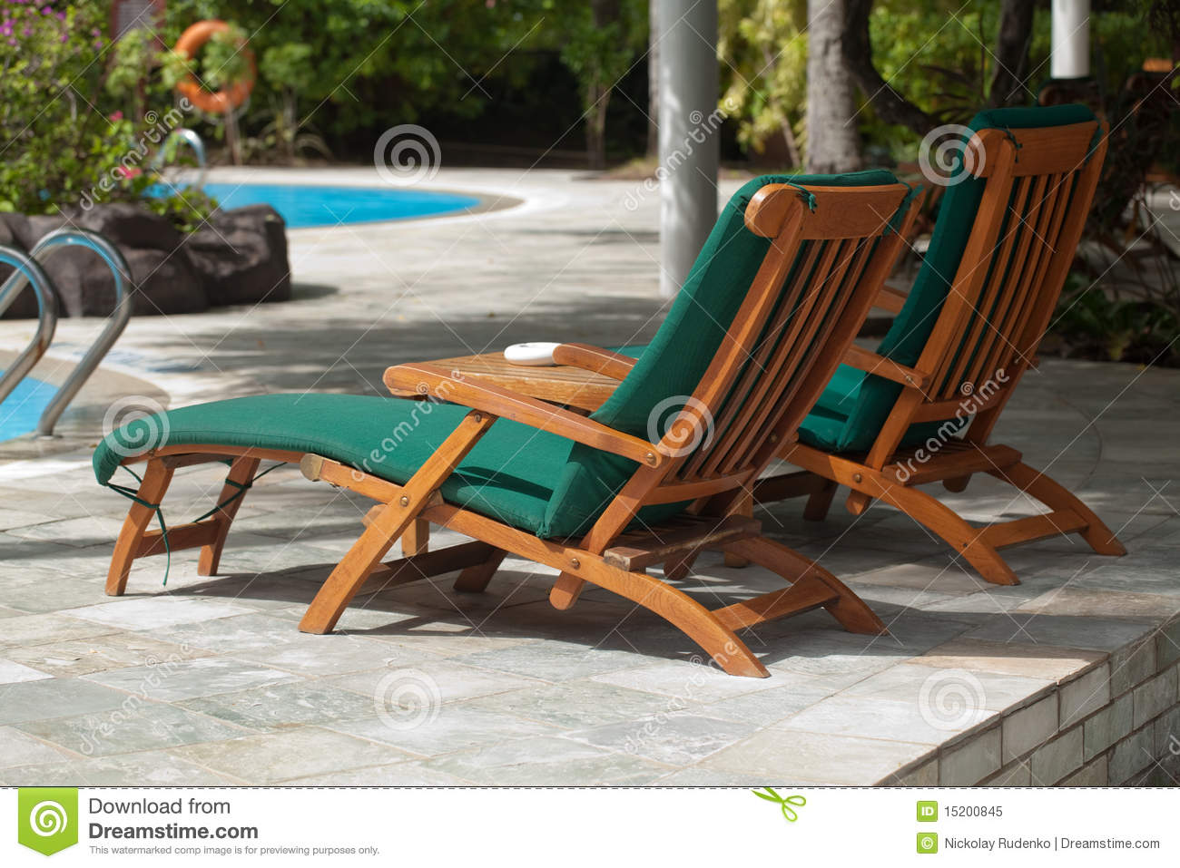 Pool lounge chair - Poolside Lounge Chairs Royalty Free Stock Photo