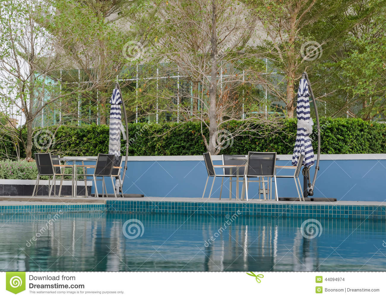 Poolside tables and chairs stock photo image 44094974 for Poolside table and chairs