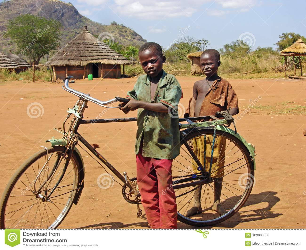 Poor African children with old bicycle remote village Africa