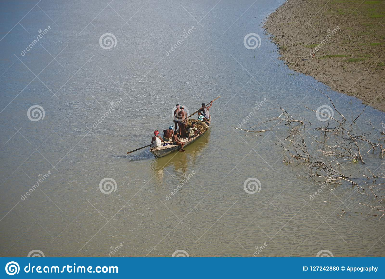 Fishermen are travelling on a boat in the river unique photo