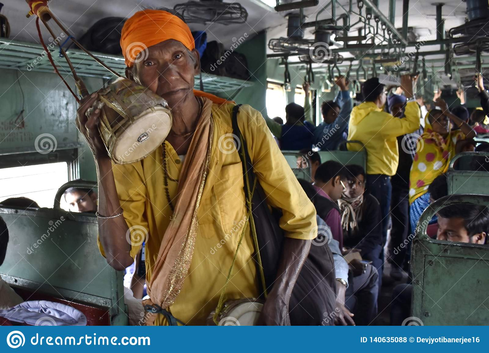 A poor beggar singing and begging on a local train