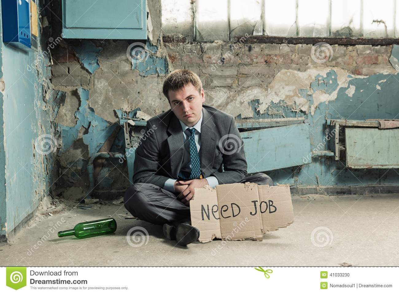 poor businessman holding sign asking for job stock photo