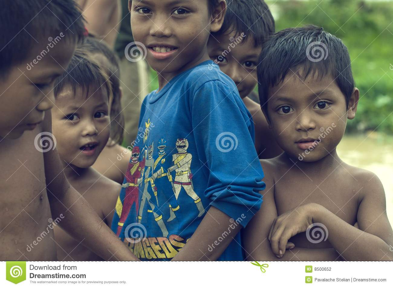 Poor cambodian kids smiling and playing