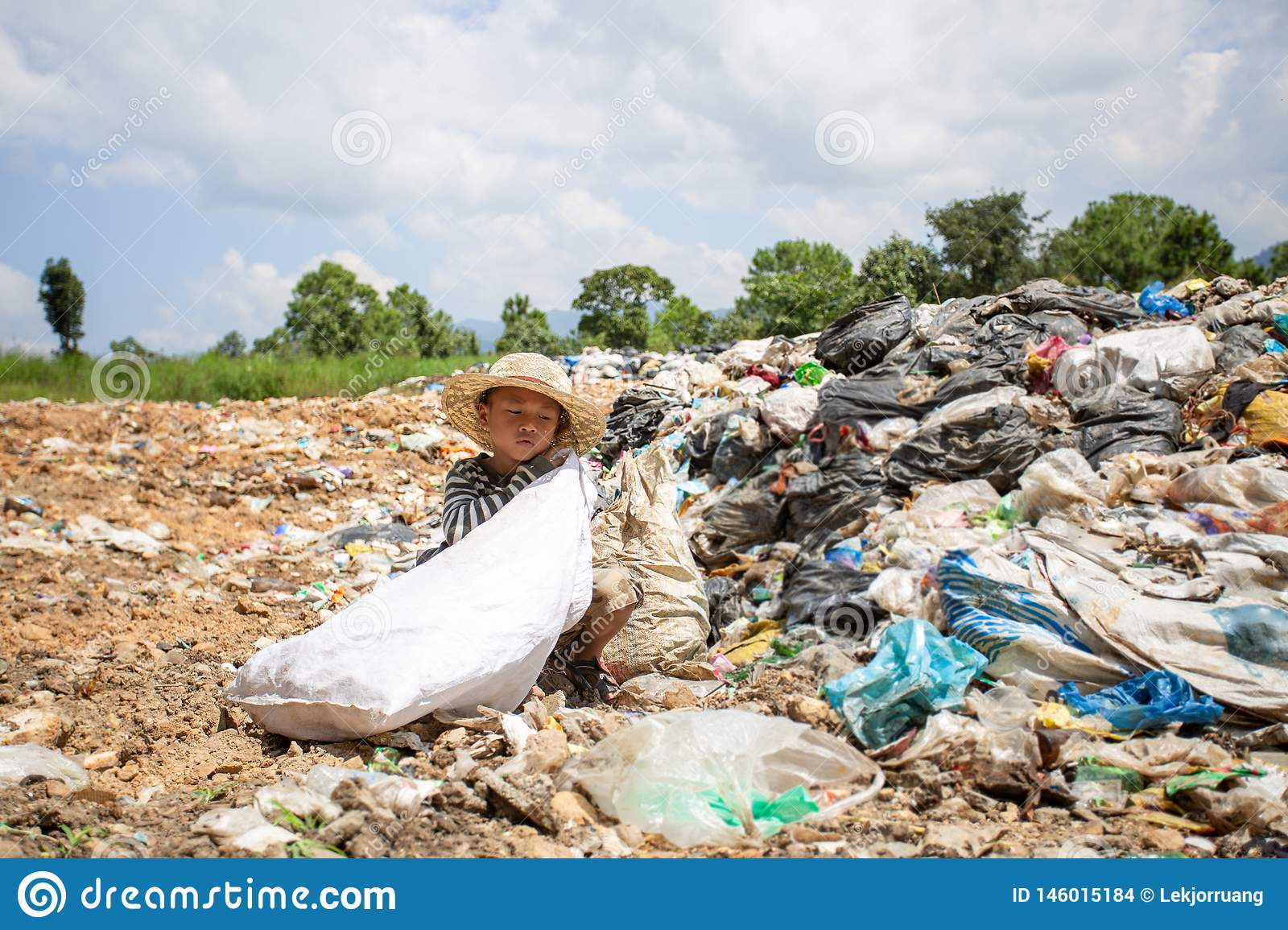 Poor children collect and sort waste for sale, concepts of poverty and the environment