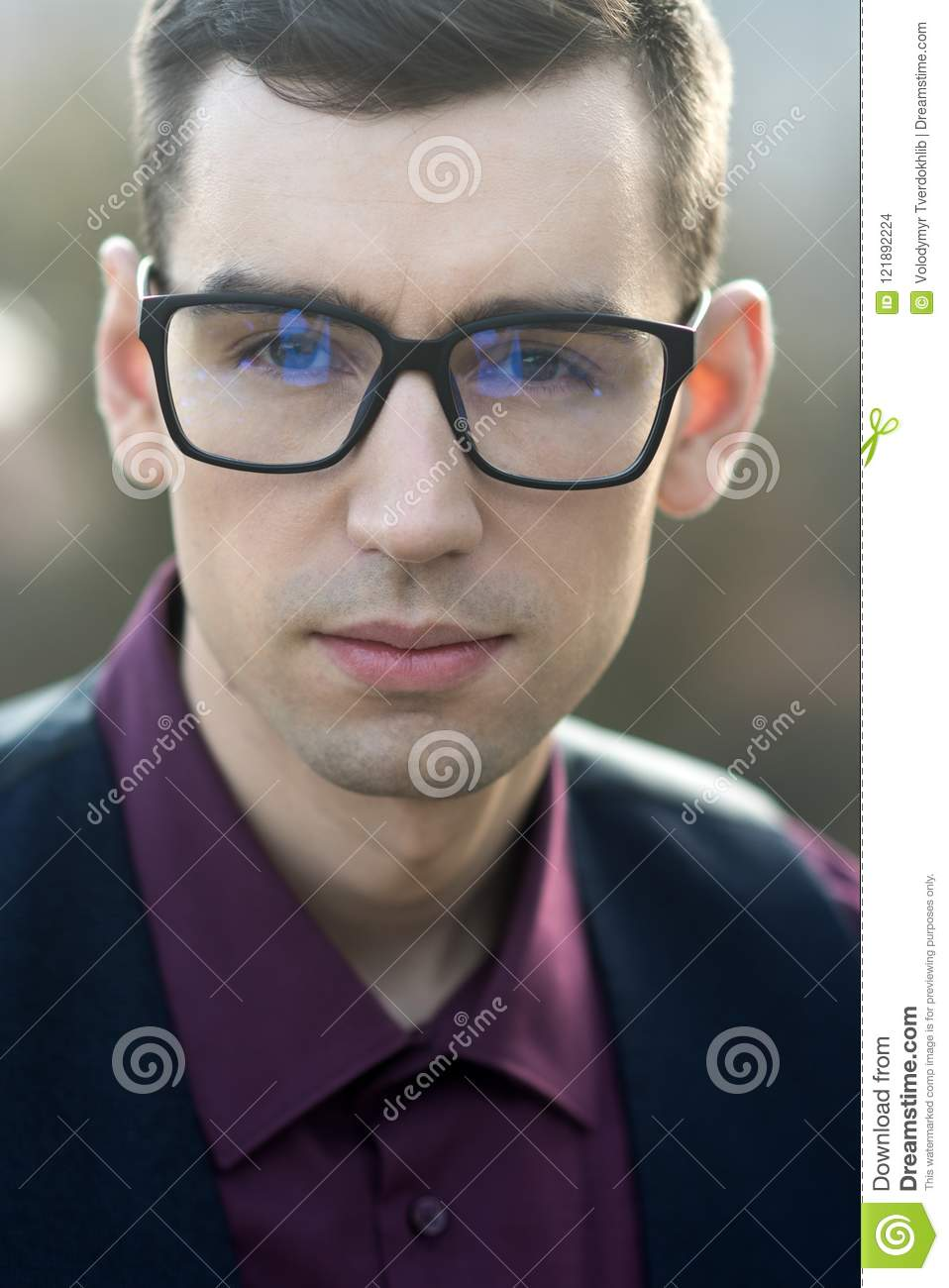 59af748fdbfe Businessman grooming in optics shop. smart fashion. Man in anti-reflection  glasses for visual improvement at oculist. barber service in barbershop  salon