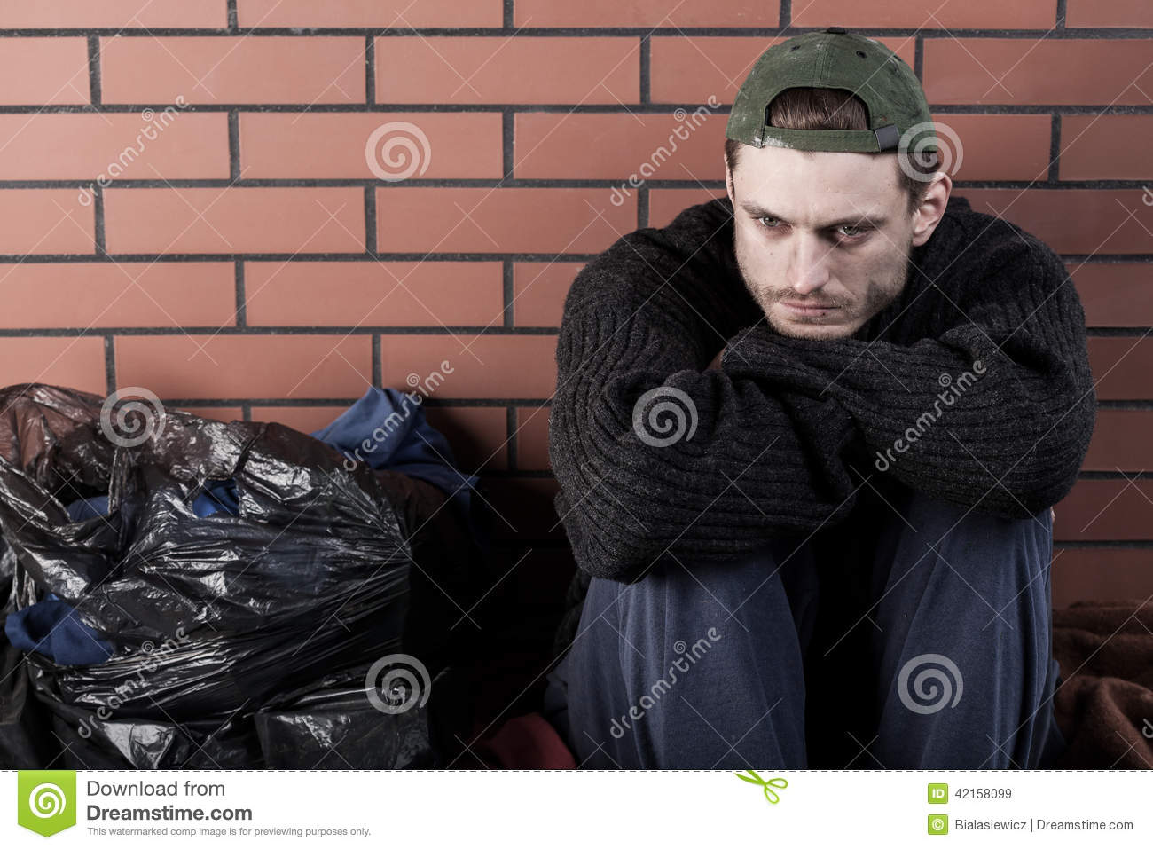 Poor Man Sitting Hunched On The Ground Stock Image Image Of Angry