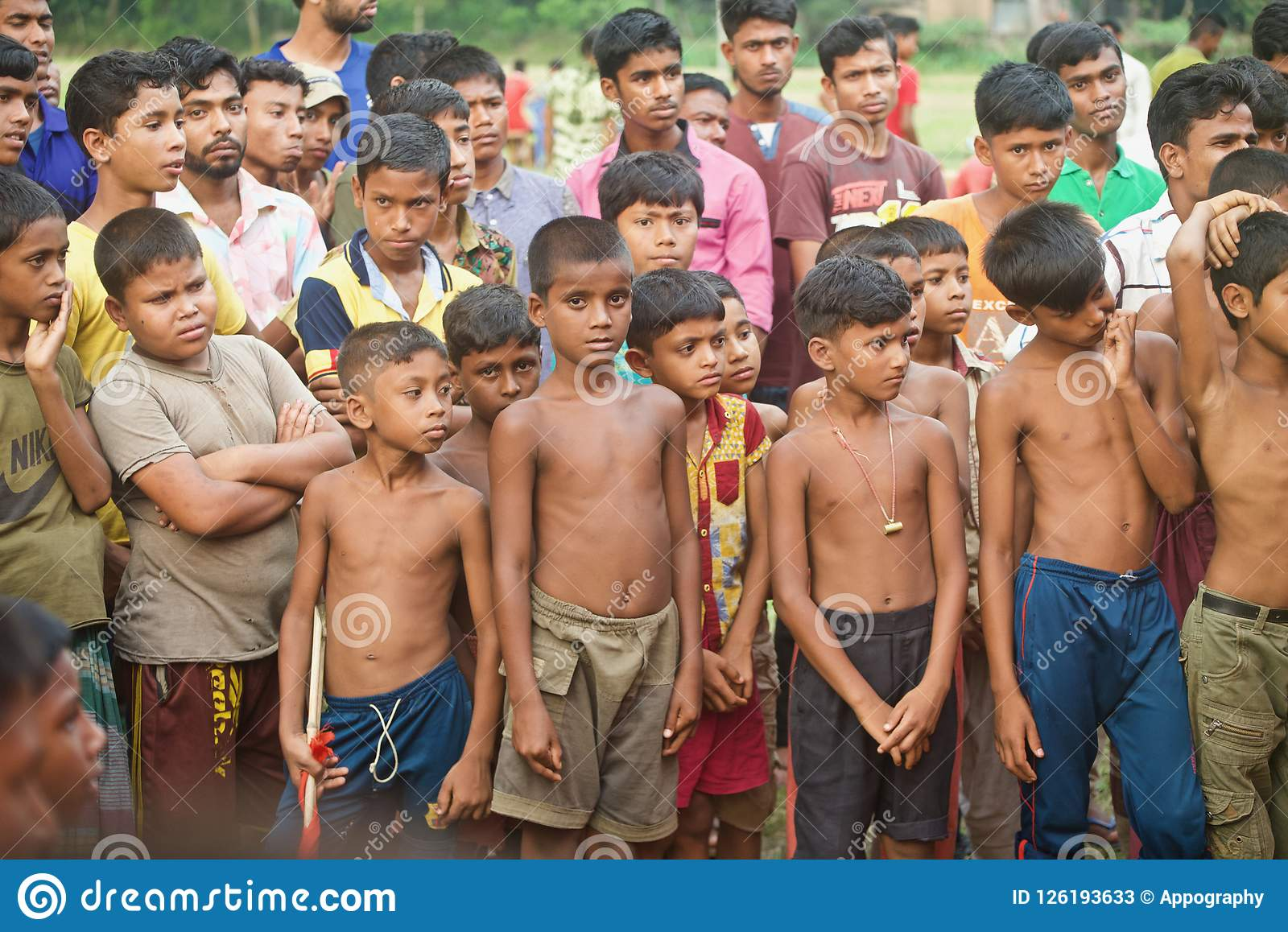 Poor village children standing together isolated unique photo