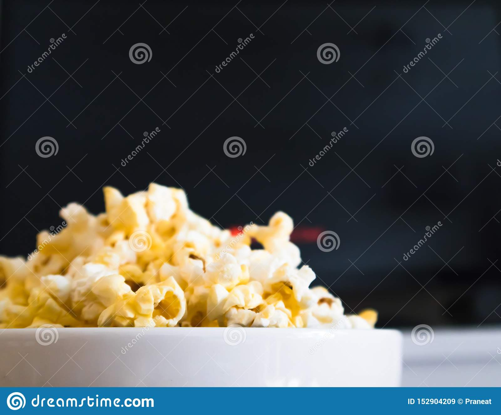 Popcorn bowl and Smart TV stock image  Image of movie