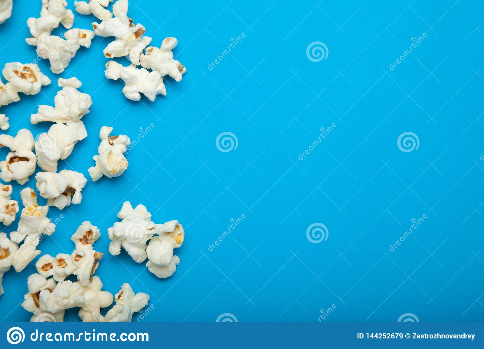 Popcorn with the copy space on the blue background