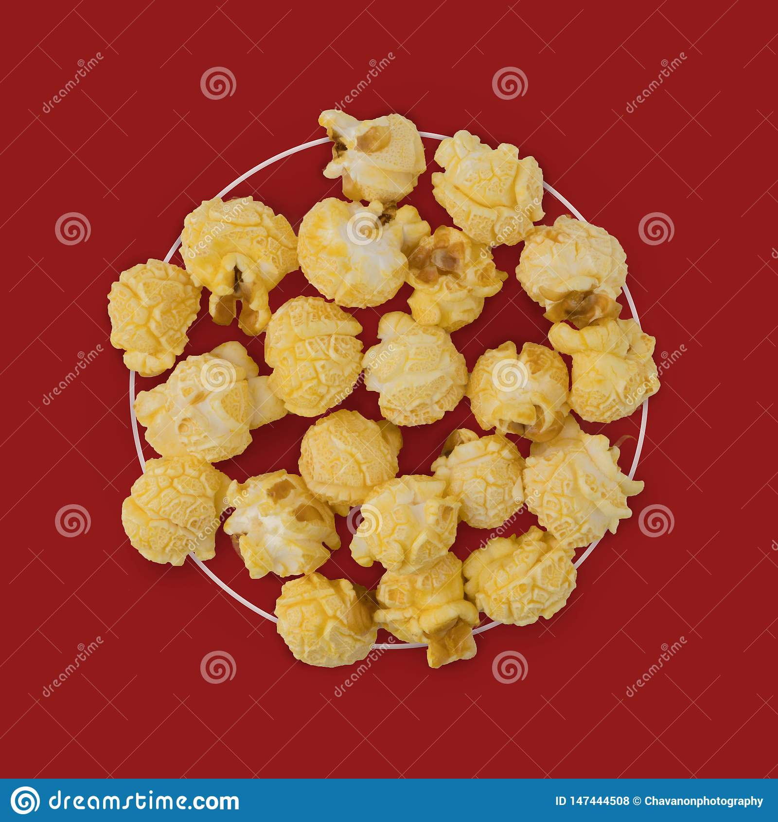 Popcorn flat lay composition on color background. cinema snack concept Modern style. creative photography. copy space