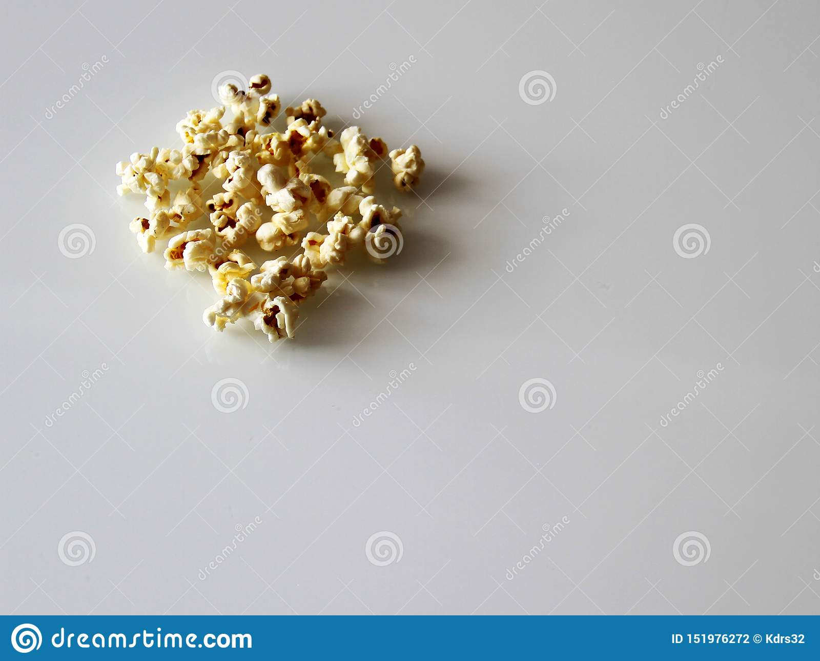 Popcorn laid out on a white glass table