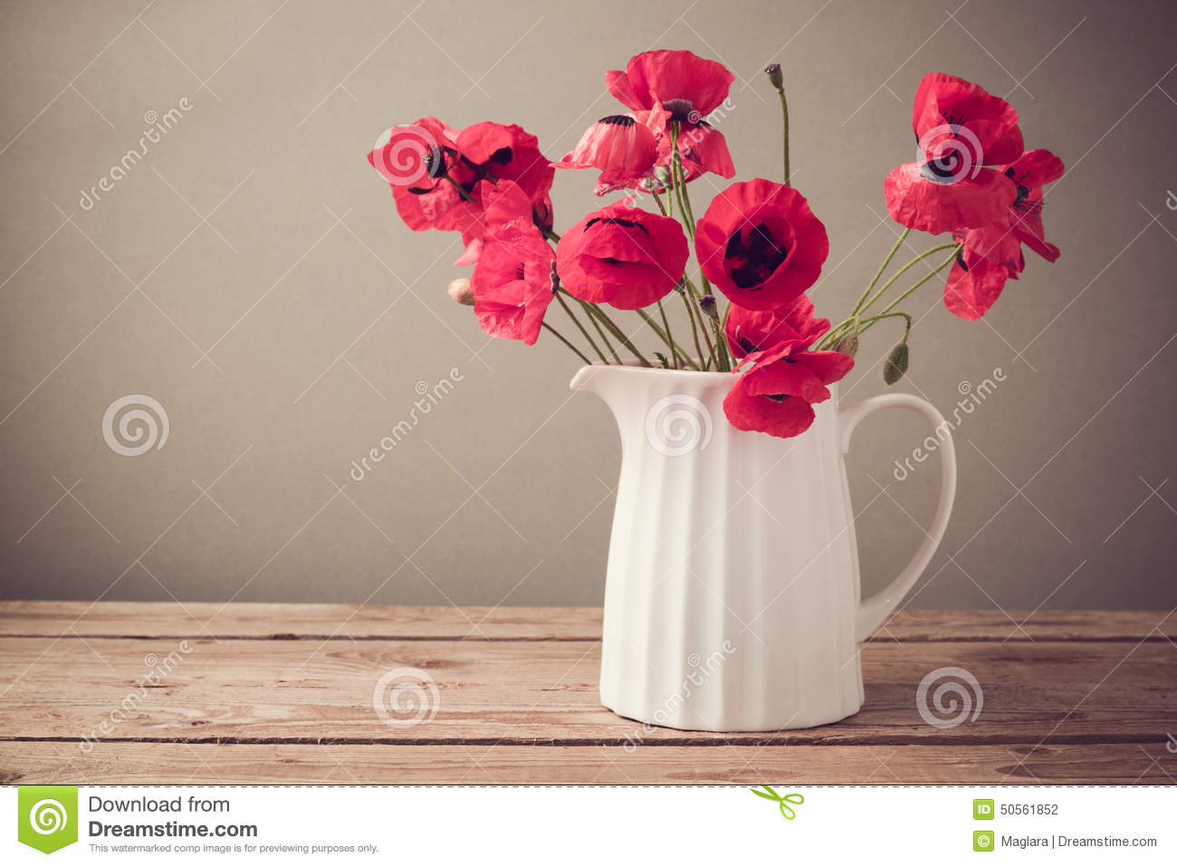 Poppy Flower Bouquet In White Jug On Wooden Table Stock Photo