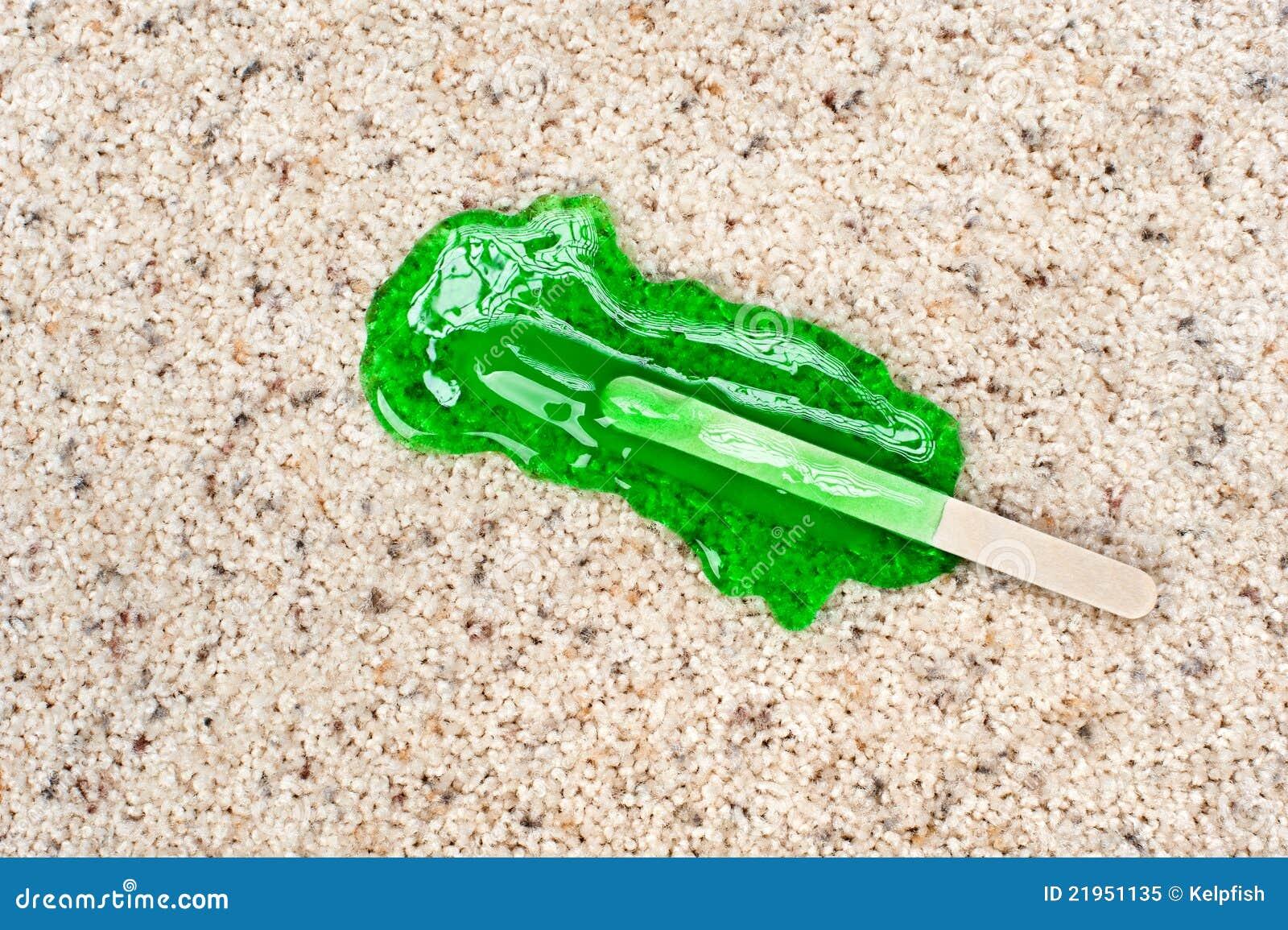 Popsicle caído en la alfombra