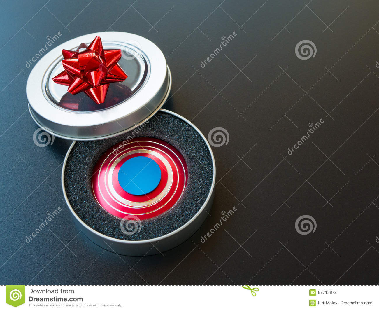 Download Popular Colourful Fidget Spinner Toy In A Gift Box On Black Background Stock Image