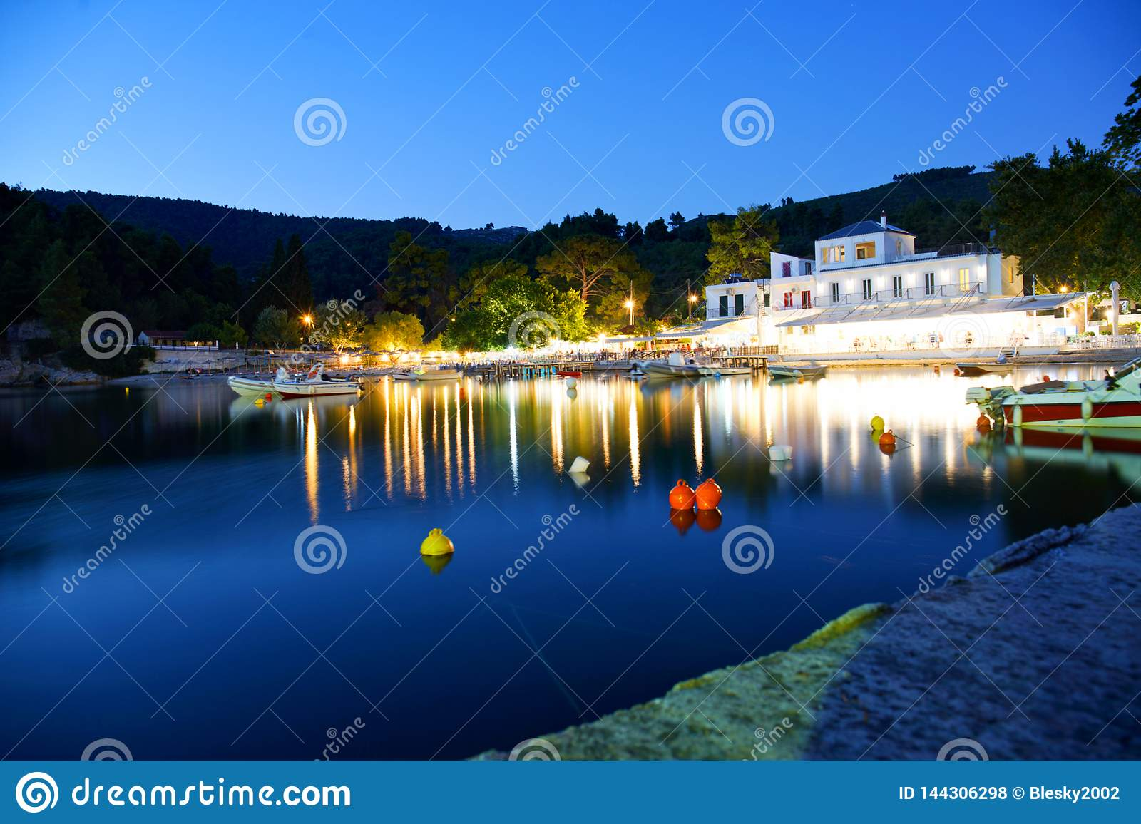 Agnontas beach and bay at sunset, Skopelos, Greece