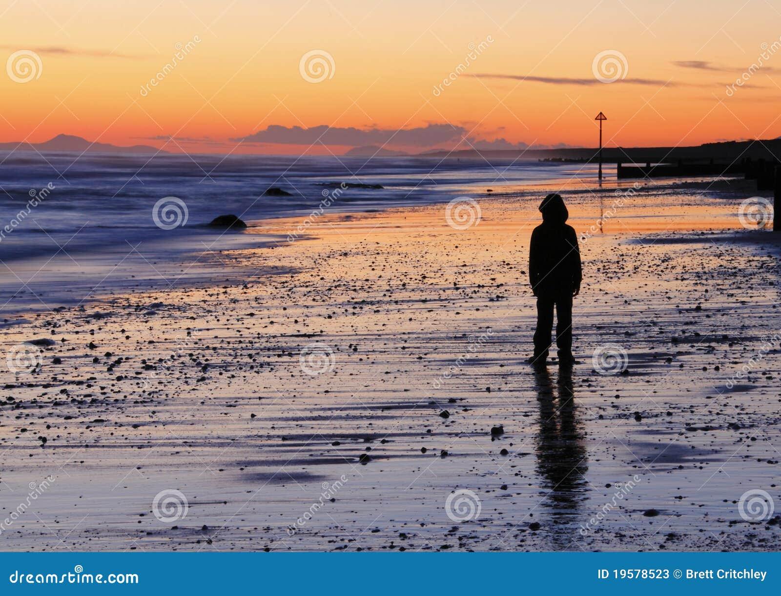 Por do sol triste da praia do menino