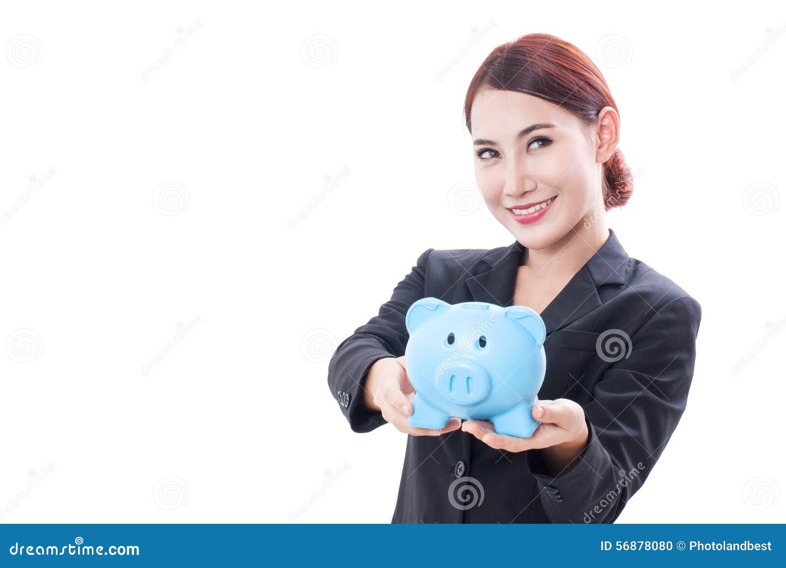 Porcellino salvadanaio felice della tenuta della donna di affari
