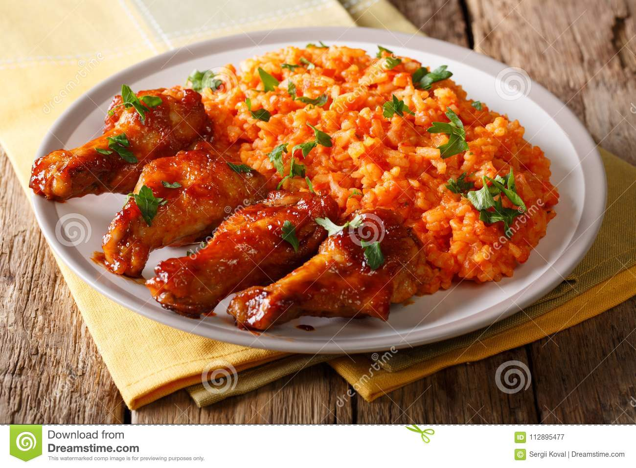 Download Porcion Of African Jollof Rice With Fried Chicken Wings Close-up Stock Image - Image of food, african: 112895477