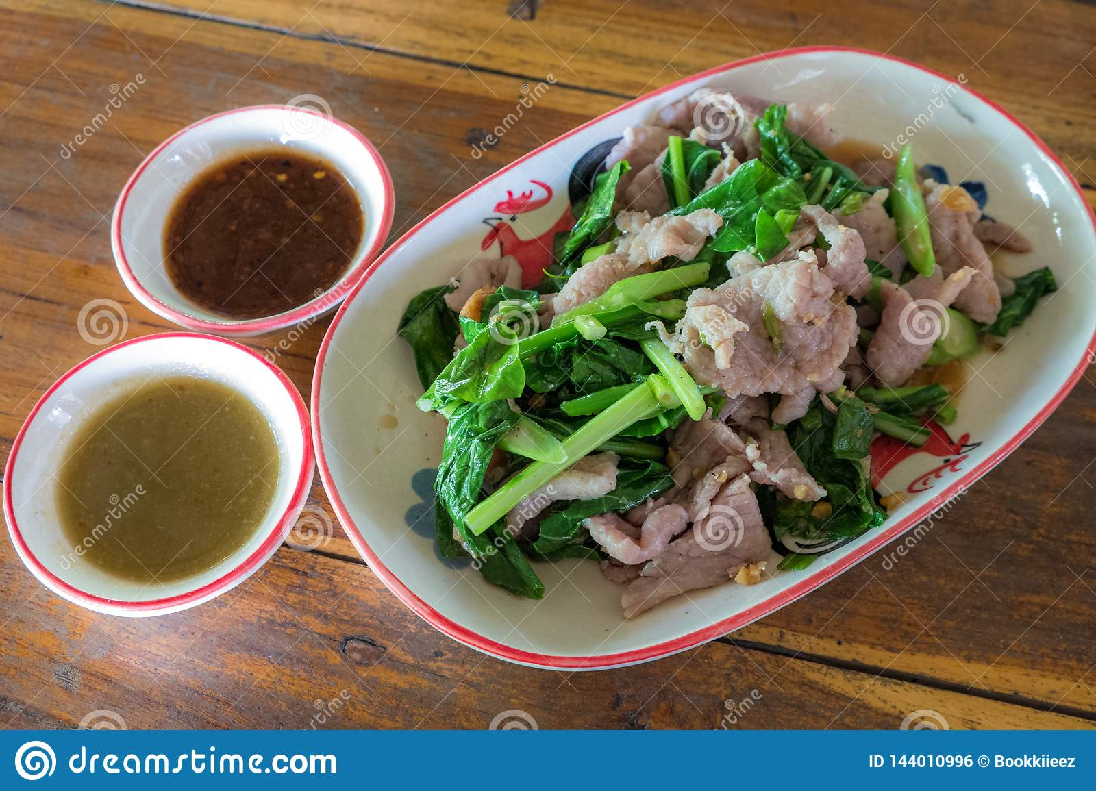 Pork boil and vegetable with spicy source. Thai food.