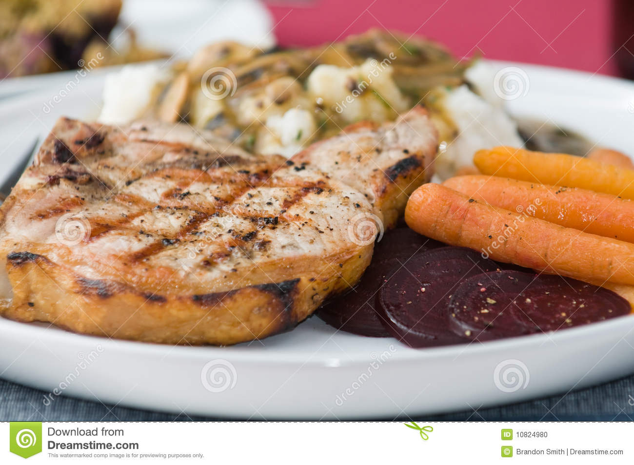 Grilled Pork Chop With Mashed Potatoes, Vegetables, Mushroom Gravy And