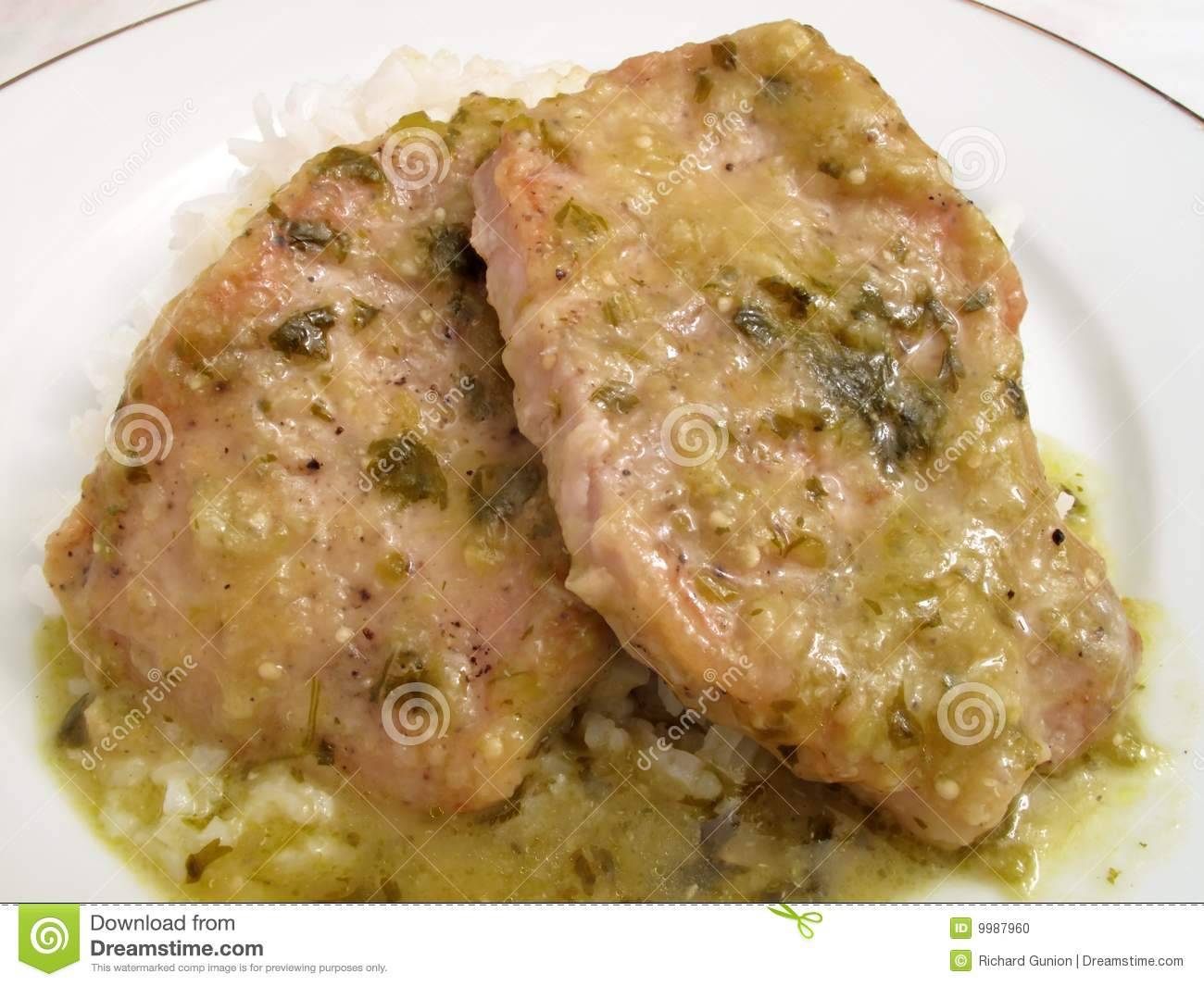 ... pork chops cooked in a spicy tomatillo sauce served with white rice