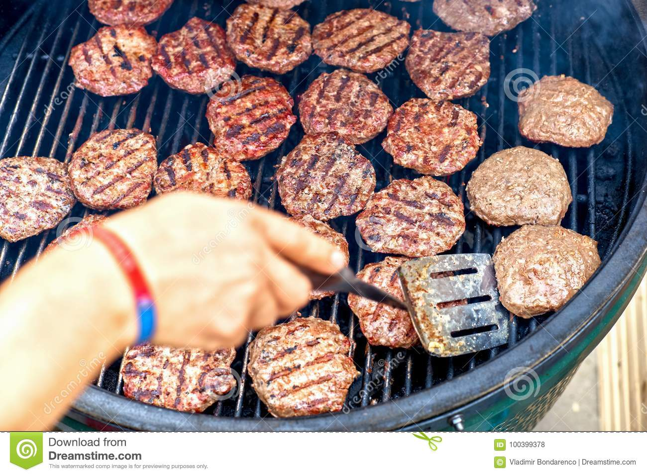 Pork meat and chicken grilling for burgers with flames and smoke