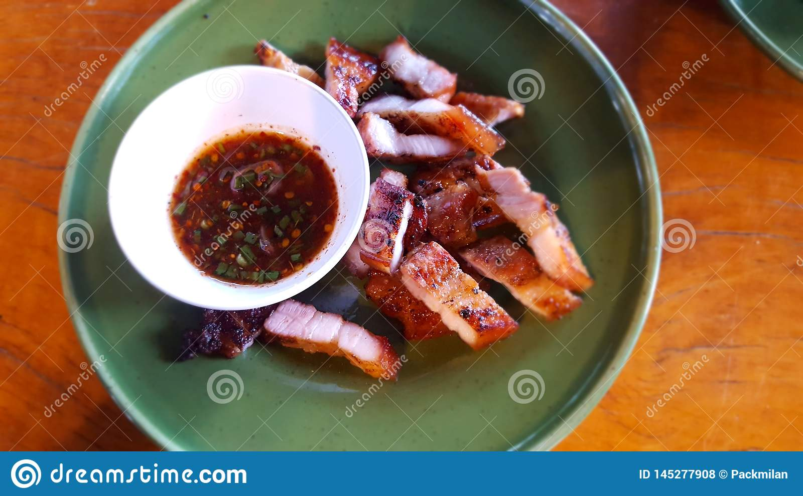 Pork neck and dipping sauce