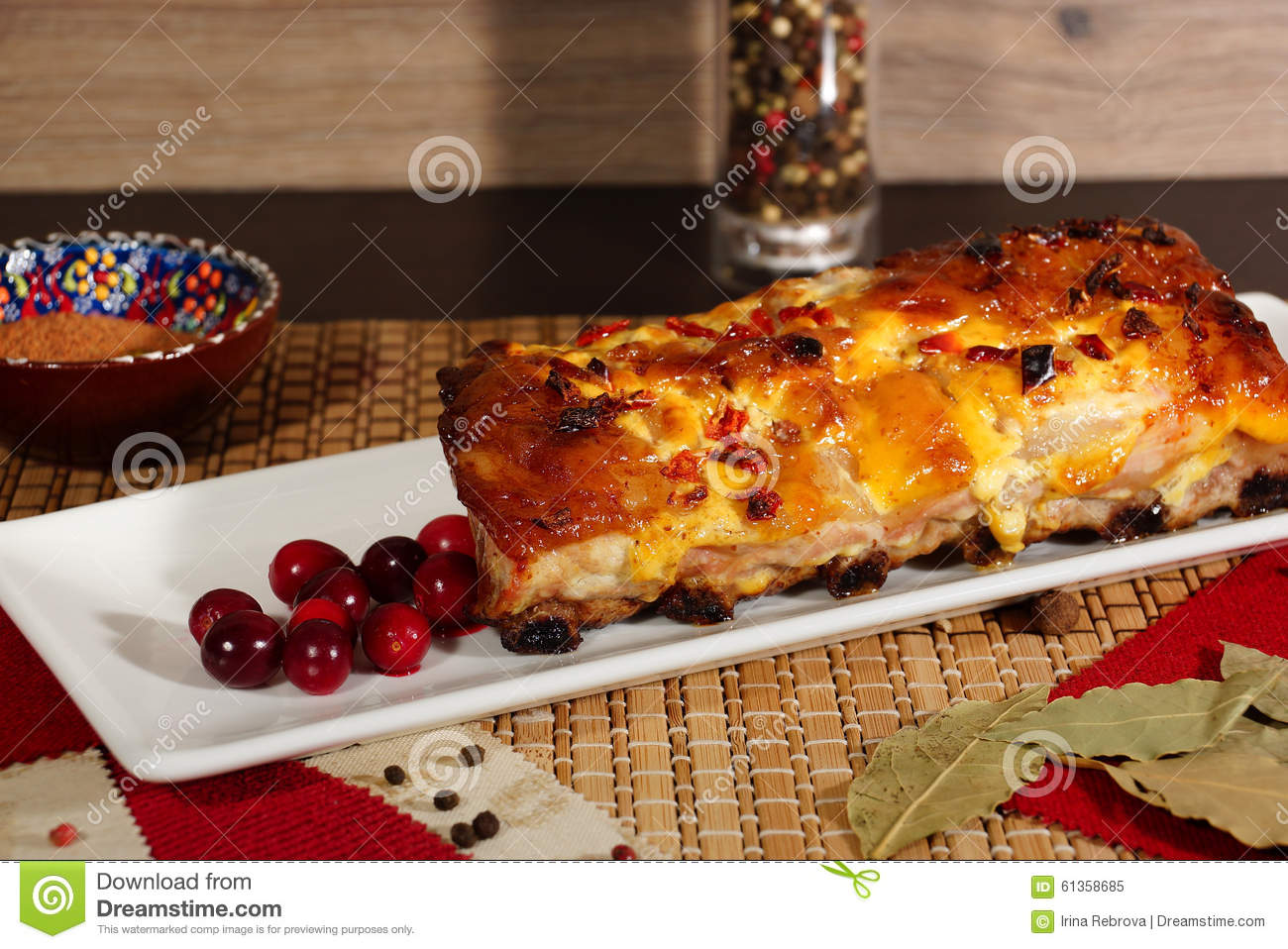 Pork ribs, baked with mustard sauce with cranberries