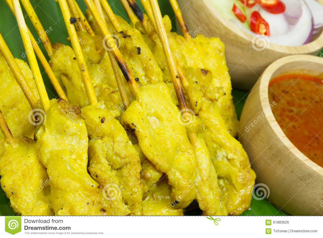 Grilled pork served with peanut sauce or sweet and sour sauce.