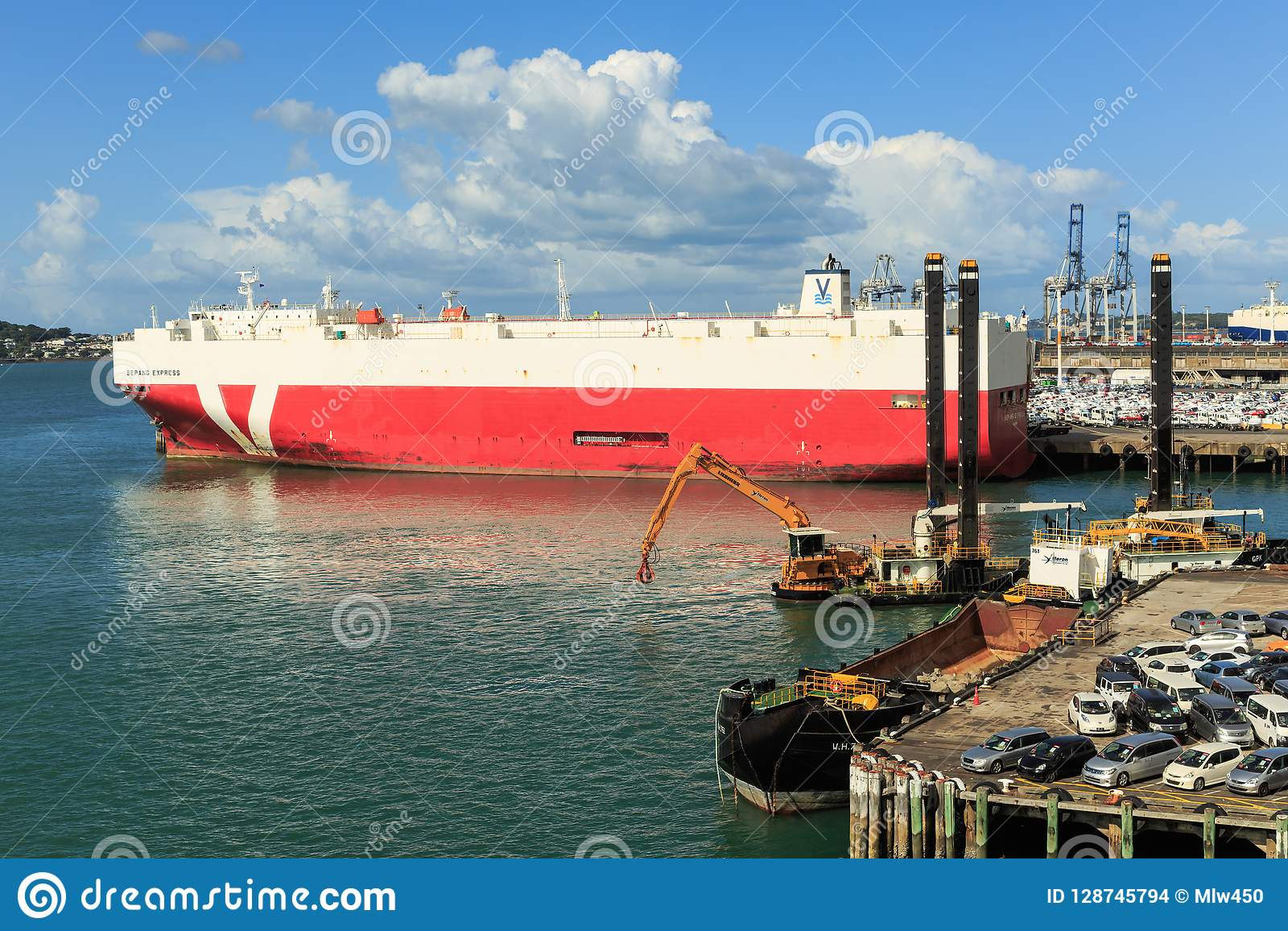 The Port of Auckland, New Zealand, with a huge vehicle carrier ship