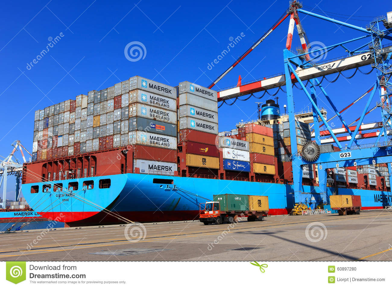Port Dock With Container Ship And Various Brands And Colors Of