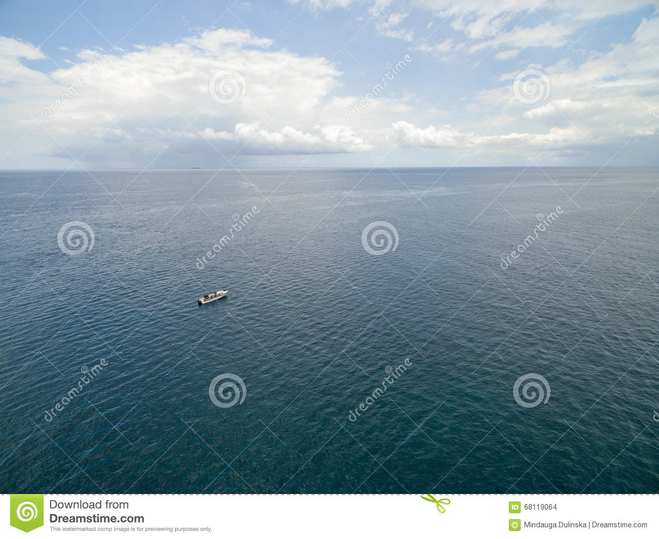 PORT LOUIS, MAURITIUS - OCTOBER 04, 2015: Lonely Boat in Indian Ocean. Close to Mauritius Coast.