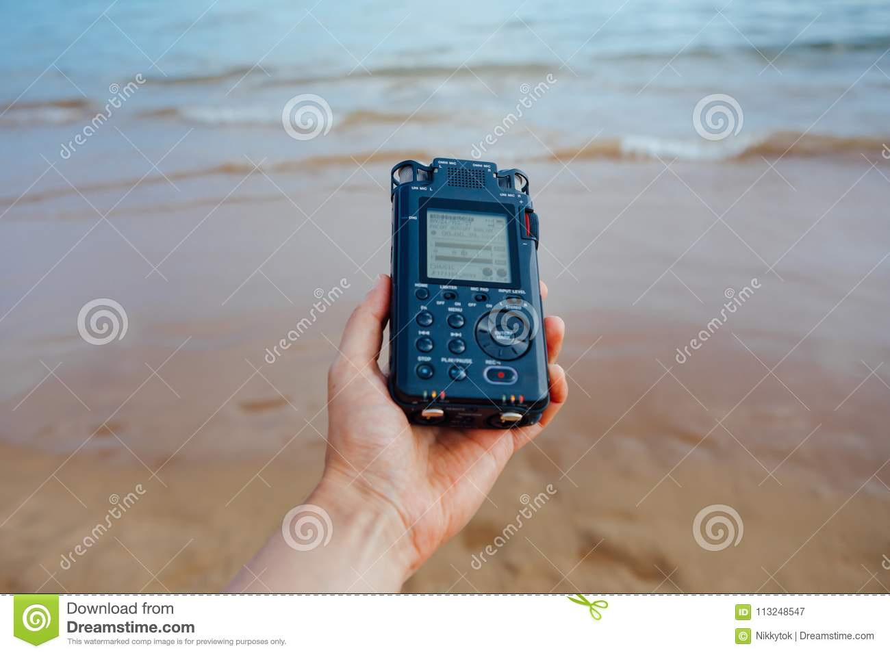 Portable Audio Recorder In Hand Recording Ambient Sounds Of