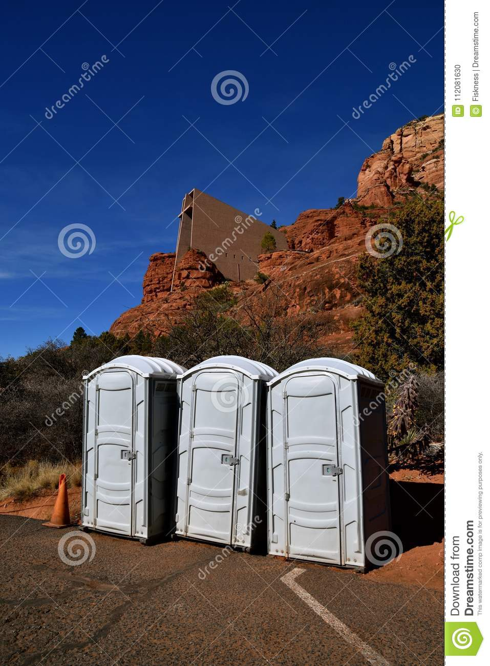 Portable bathrooms in front of Chapel of the Cross