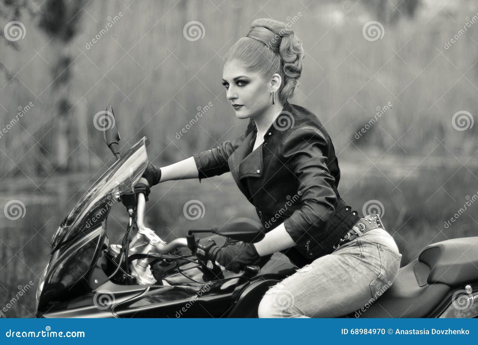 Biker girl black and white photo professional biker girlfast ridersitting on blackfastmodern motorbikemotorcyclebike sexy biker girl with creative