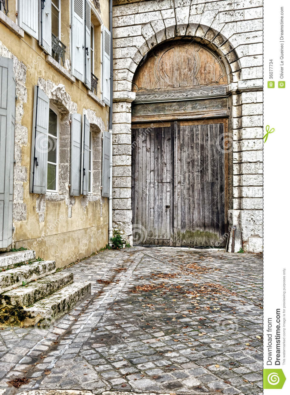 Porte cochere carriage entrance on old french house stock for French porte
