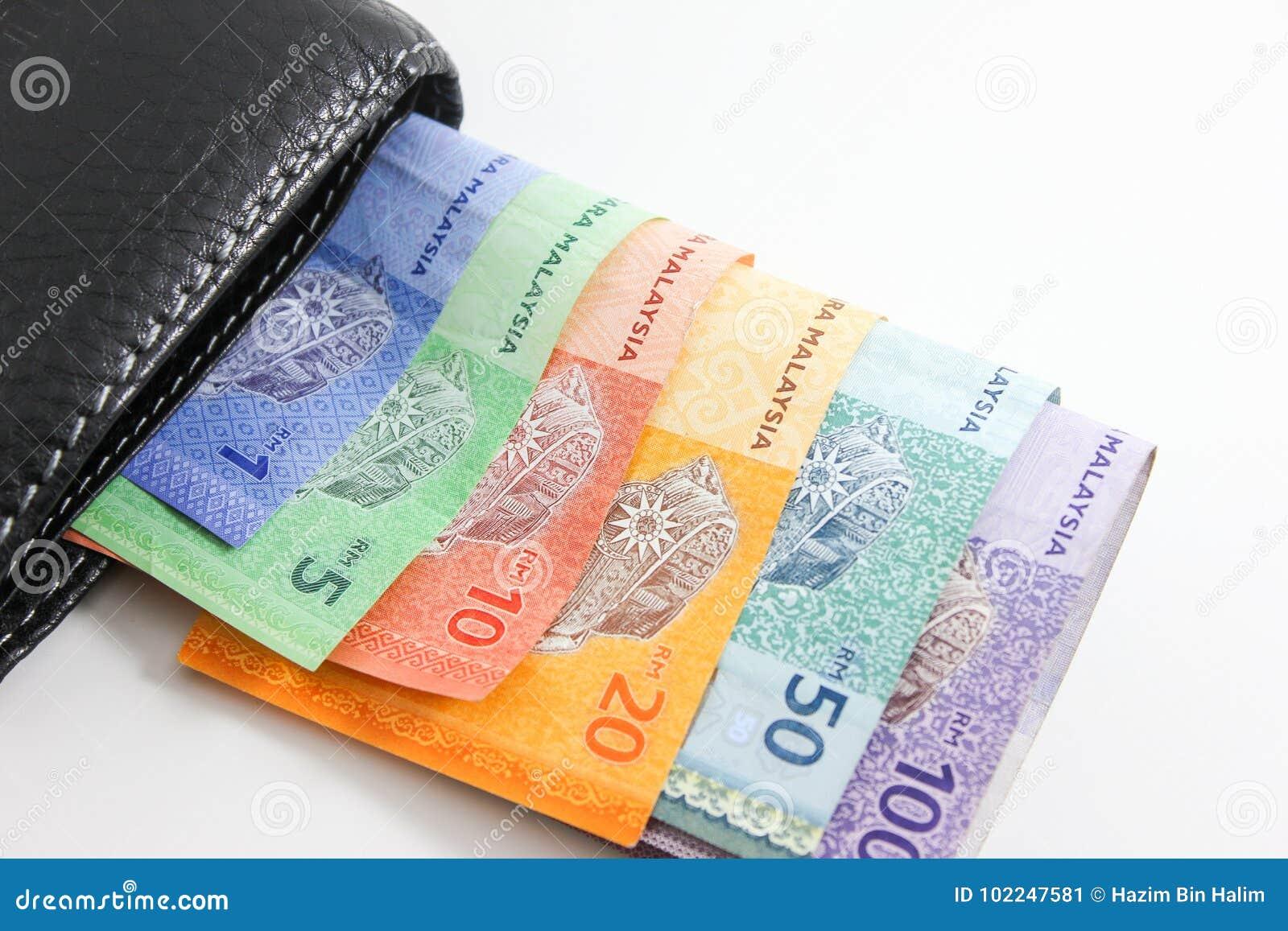 Portefeuille noir avec des billets de banque de ringgit de la Malaisie